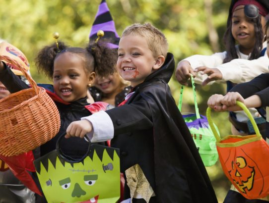 Multi-ethnic children dressed in Halloween costumes
